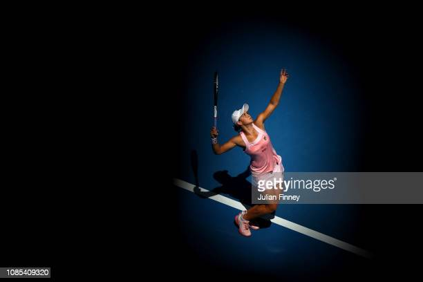 Ashleigh Barty of Australia serves in her fourth round match against Maria Sharapova of Russia during day seven of the 2019 Australian Open at...
