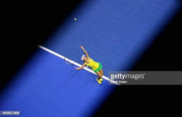 Ashleigh Barty of Australia serves in her match against Lesley Kerkhove of the Netherlands during the World Group PlayOff Fed Cup tie between...