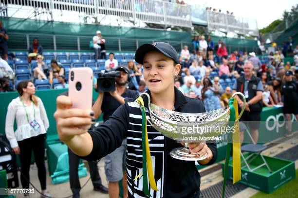 Ashleigh Barty of Australia takes a selfie with the Maud Watson Trophy after victory in her final match Julia Goerges of Germany after victory in her...