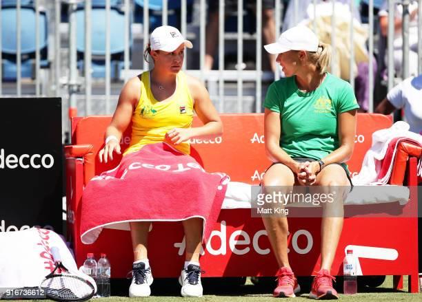Ashleigh Barty of Australia talks to Australia captain Alicia Molik between games in her singles match against Marta Kostyuk of Ukraine during the...