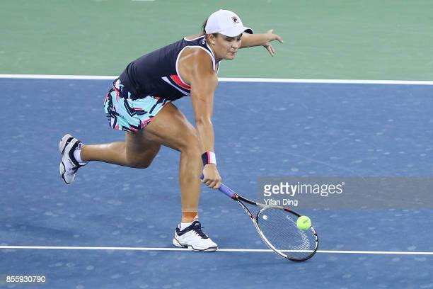 Ashleigh Barty plays a backhand during the ladies singles final between Ashleigh Barty of Australia and Caroline Garcia of France during Day 7of 2017...