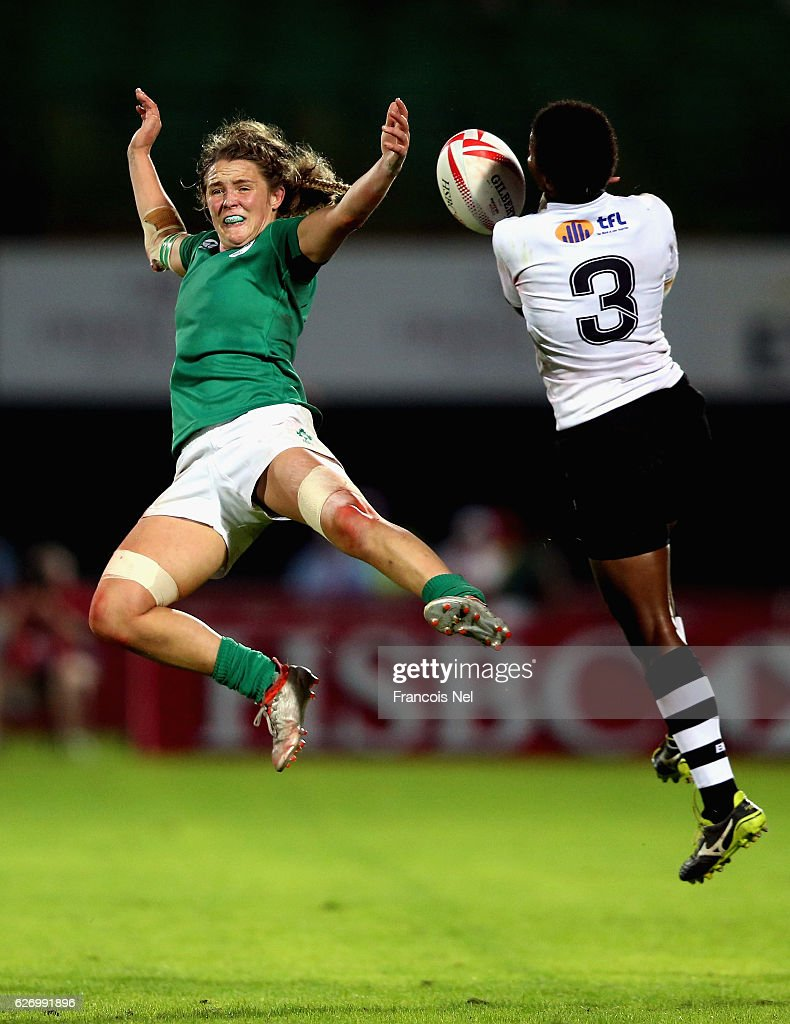 Ashleigh Baxter of Ireland competes for the ball with Raijieli Daveua of Fiji during day one of the Emirates Dubai Rugby Sevens - HSBC World Rugby Women's Sevens Series on December 1, 2016 in Dubai, United Arab Emirates.