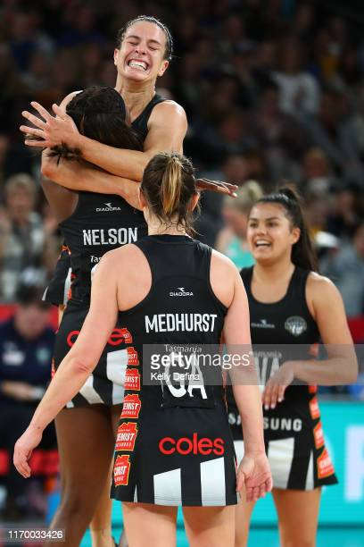 Ashleigh Brazill of the Magpies and team mates celebrate the Magpies win during the round 14 Super Netball match between the Collingwood Magpies and...