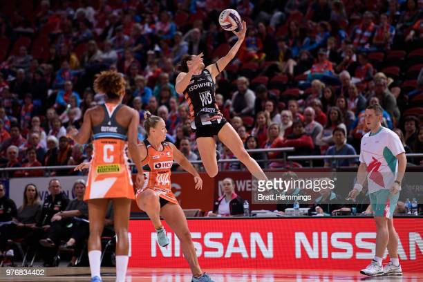 Ashleigh Brazill of the Magpies leaps to catch the ball during the round seven Super Netball match between the Giants and the Magpies at Qudos Bank...
