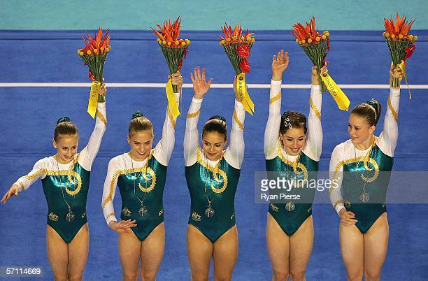 Ashleigh Brennan Hollie Dykes Monette Russo Chloe Sims and Naomi Russell of Australia celebrate winning Gold in the Womens Artistic Gymnastics at the...