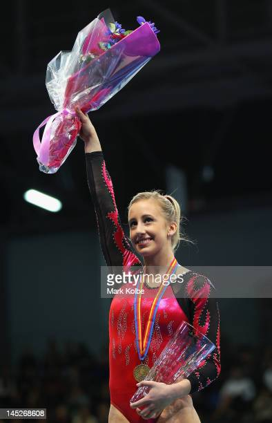 Ashleigh Brennan of Victoria acknowledges the crowd after winning the women's gymnastics senior international all round competition on day four of...