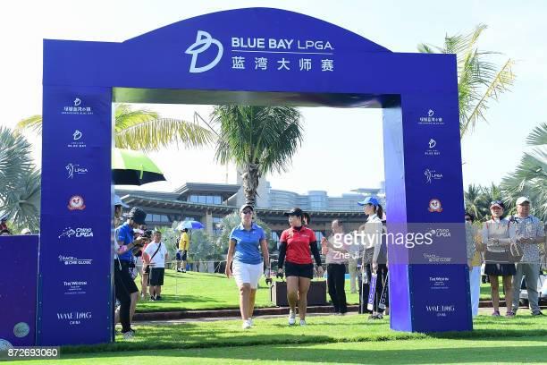 Ashleigh Buhai of South Africa and Moriya Jutanugarn of Thailand play a shot on the 1st hole during the final round of the Blue Bay LPGA at Jian Lake...