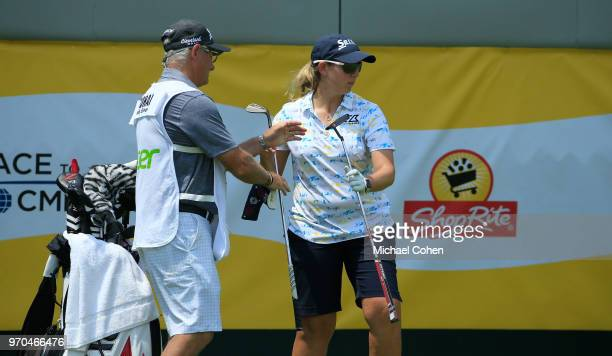 Ashleigh Buhai of South Africa changes clubs on the 18th green during the second round of the ShopRite LPGA Classic Presented by Acer on the Bay...