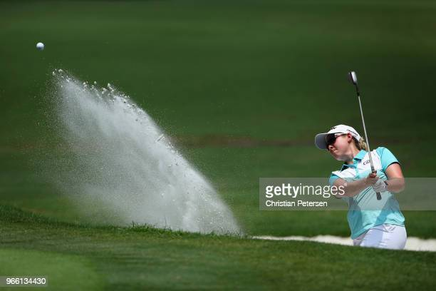 Ashleigh Buhai of South Africa chips from the bunker onto the first green during the thrid round of the 2018 US Women's Open at Shoal Creek on June 2...