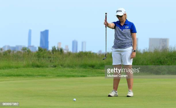 Ashleigh Buhai of South Africa lines up her birdie putt on the seventh green during the first round of the ShopRite LPGA Classic Presented by Acer on...