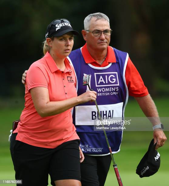 Ashleigh Buhai of South Africa looks on with her caddie after her round during Day Two of the AIG Women's British Open at Woburn Golf Club on August...