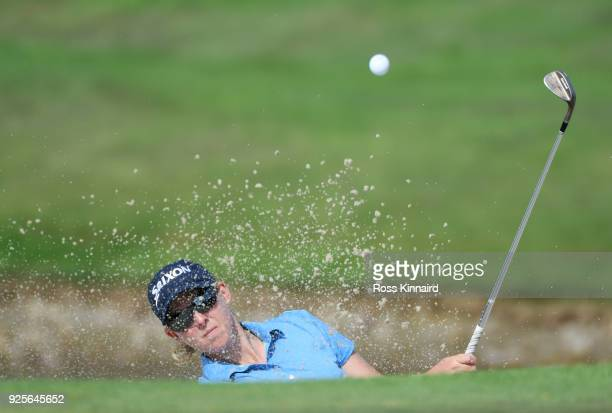 Ashleigh Buhai of South Africa plays a shot from a bunker on the 15th hole during round one of the HSBC Women's World Championship at Sentosa Golf...