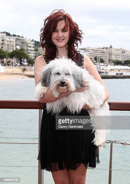 Ashleigh Butler and Pudsey attend the photocall for 'PudseyThe Movie' at The 66th Annual Cannes Film Festival on May 16 2013 in Cannes France