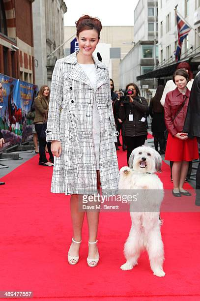 Ashleigh Butler and Pudsey attend the World Premiere of 'Postman Pat' at Odeon West End on May 11 2014 in London England