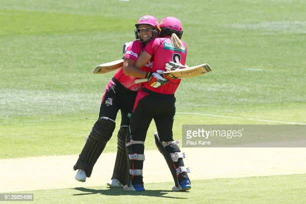 Ashleigh Gardner and Ellyse Perry of the Sixers celebrate winning the Women's Big Bash League final match between the Sydney Sixers and the Perth...