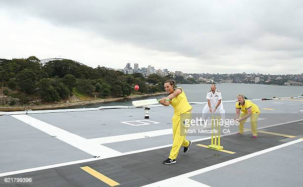 Ashleigh Gardner bats as Sarah Beard keeps wicket aboard the HMAS Canberra during a Cricket Australia media opportunity on November 9 2016 in Sydney...