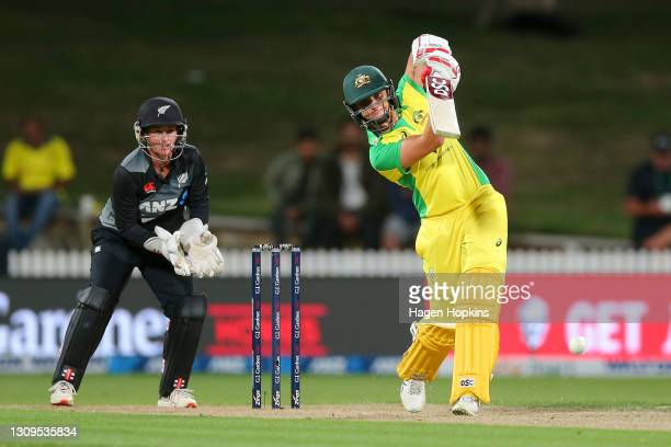 Ashleigh Gardner of Australia bats while s of New Zealand looks on during game one of the International T20 series between New Zealand and Australia...