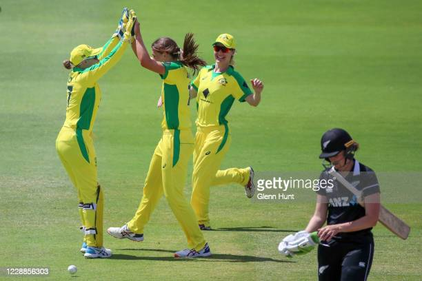 Ashleigh Gardner of Australia celebrates after getting the wicket of Amy Satterthwaite of New Zealand during game one in the women's One Day...