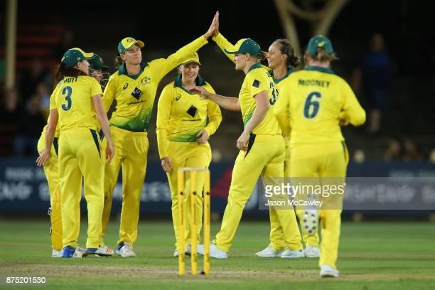 Ashleigh Gardner of Australia celebrates the wicket of Danielle Wyatt of England during the first Women's Twenty20 match between Australia and...
