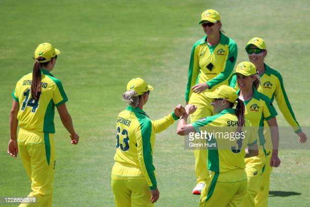 Ashleigh Gardner of Australia celebrates with team mates after catching out Suzie Bates of New Zealand during game one in the women's One Day...