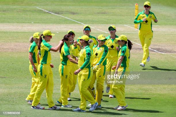 Ashleigh Gardner of Australia celebrates with teammates after catching out Natalie Dodd of New Zealand during game one in the women's One Day...