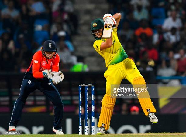 Ashleigh Gardner of Australia hits 4 as Amy Jones of England looks on during the ICC Women's World T20 final cricket match between Australia and...