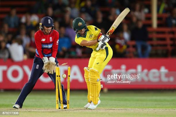 Ashleigh Gardner of Australia is bowled by Alex Hartley of England during the first Women's Twenty20 match between Australia and England at North...