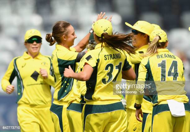 Ashleigh Gardner of Australia is congratulated by team mates after getting the wicket of Amy Satterthwaite of New Zealand during the second Women's...