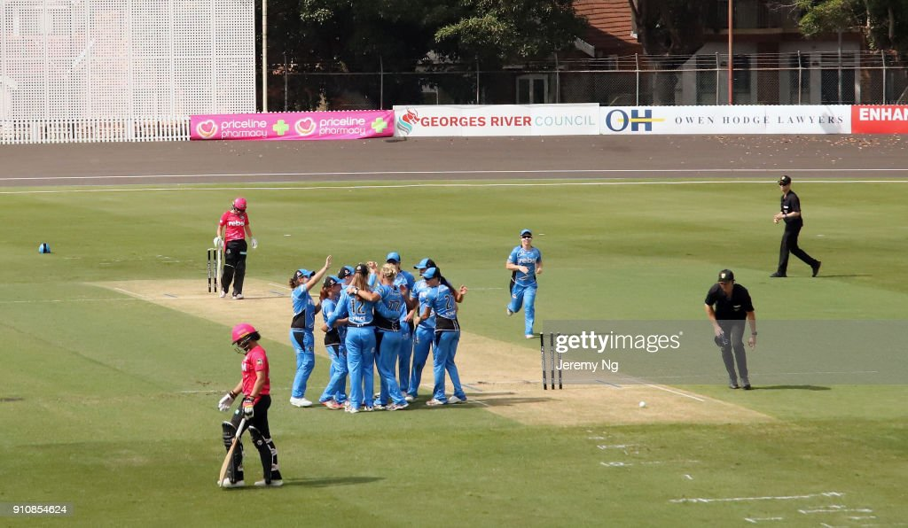 Ashleigh Gardner of the Sixers is run out as the Adelaide Strikers celebrate during the Women's Big Bash League match between the Adelaide Strikers and the Sydney Sixers at Hurstville Oval on January 27, 2018 in Sydney, Australia.