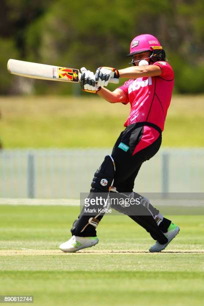 Ashleigh Gardner of the Sixers is struck on the helmet by Katherine Brunt of the Scorchers during the Women's Big Bash League match between the Perth...