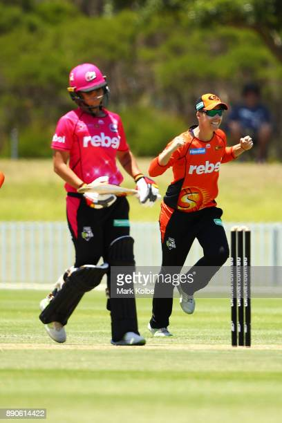 Ashleigh Gardner of the Sixers looks dejected as Elyse Villani of the Scorchers celebrates her dismissal during the Women's Big Bash League match...