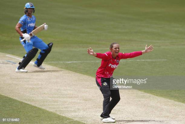 Ashleigh Gardner of the Sixers reacts after taking the wicket of Suzie Bates of the Strikers during the Women's Big Bash League match between the...