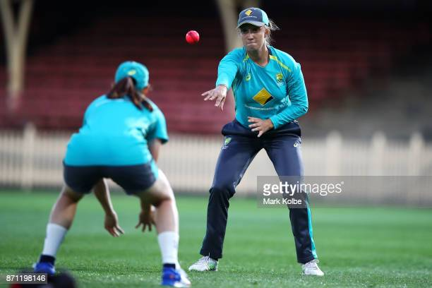 Ashleigh Gardner throws a catch during an Australian women's Ashes series training session at North Sydney Oval on November 7 2017 in Sydney Australia