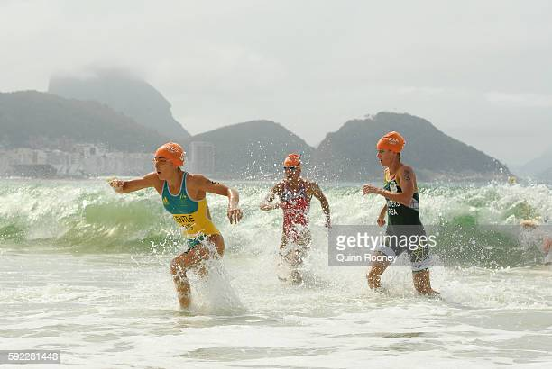 Ashleigh Gentle of Australia Agnieszka Jerzyk of PolTrinidad and Tobago and Gillian Sanders of South Africa race from the water during the Women's...