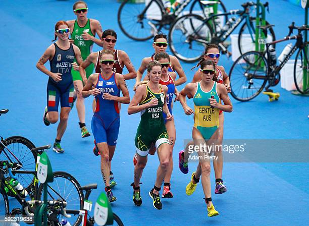 Ashleigh Gentle of Australia and Gillian Sanders of South Africa lead a group during the Women's Triathlon on Day 15 of the Rio 2016 Olympic Games at...
