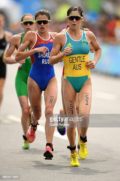 Ashleigh Gentle of Australia and Mariia Shorets of Russia run during the Women's Triathlon on Day 15 of the Rio 2016 Olympic Games at Fort Copacabana...