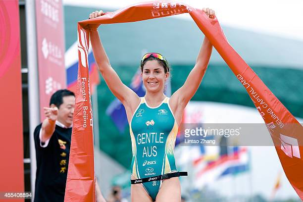 Ashleigh Gentle of Australia celebrates after winning the Women's professional group during the 2014 Beijing International Triathlon at Beijing...