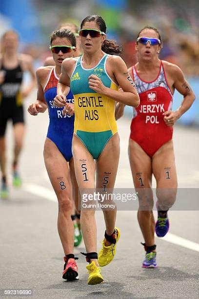 Ashleigh Gentle of Australia Mariia Shorets of Russia and Agnieszka Jerzyk of Poland run during the Women's Triathlon on Day 15 of the Rio 2016...