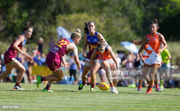 Ashleigh Guest of the Giants in action with Nicole Hildebrand of the Lions during the round four Women's AFL match between the Brisbane Lions and the...