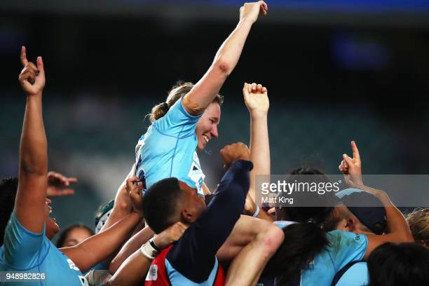 Ashleigh Hewson of New South Wales and team mates celebrate victory during the Super W Grand Final match between the the New South Wales Women and...