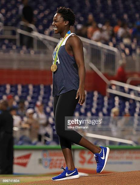 Ashleigh Johnson of the gold medal winning USA Water Polo team throws out the first pitch during a game between the Miami Marlins and the...