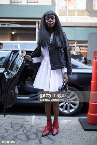 Ashleigh Murray is seen on the street attending Zadig Voltaire during New York Fashion Week wearing a white dress with black leather jacket on...