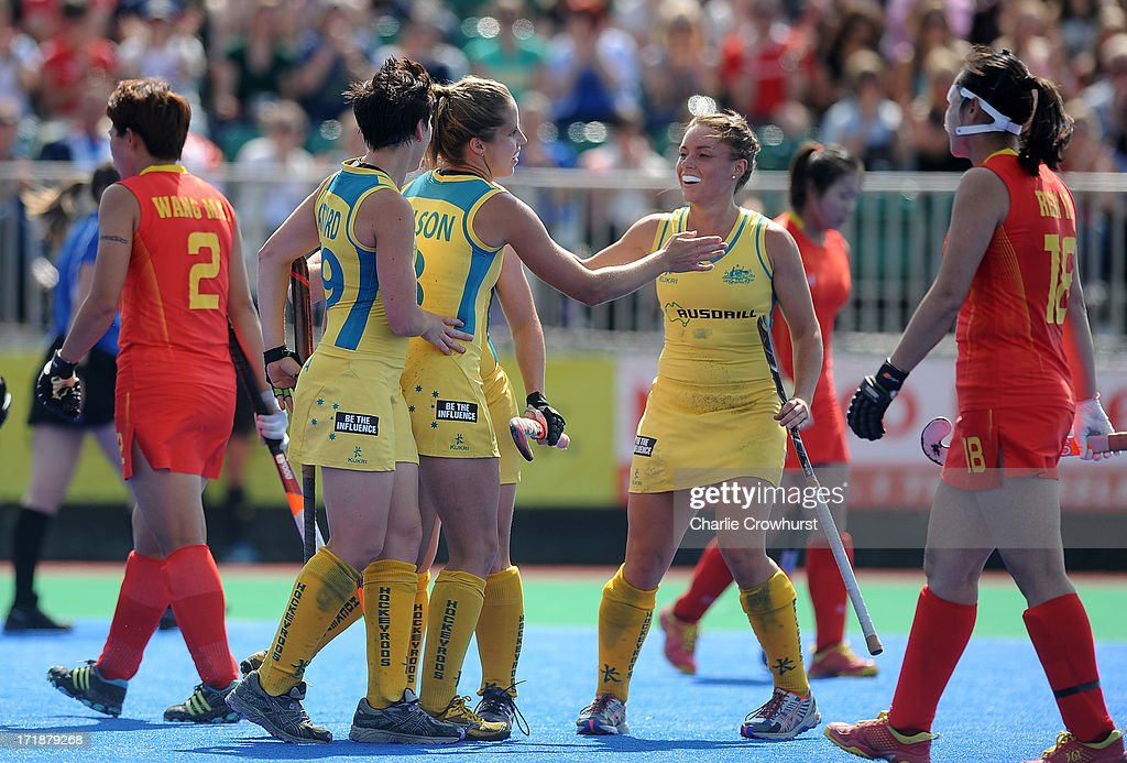 Ashleigh Nelson of Australia celebrates scoring the teams first goal with team mates during the Investec Hockey World League - Semi Finals match between China and Australia at The University of Westminster Sports Ground on June 29, 2013 in London, England.