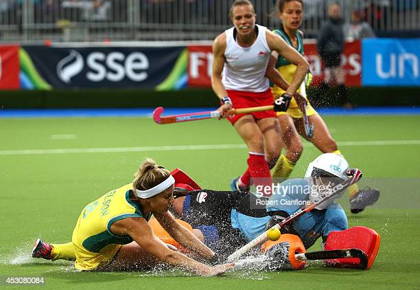 Ashleigh Nelson of Australia collides with goalkeeper Maddie Hinch of England in the Women's Gold Medal Match at Glasgow National Hockey Centre...