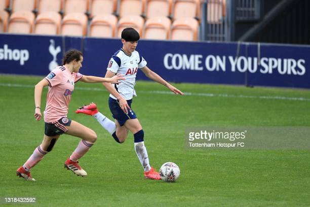 Ashleigh Neville of Tottenham Hotspur and Rhema Lord-Mears of Sheffield United during the Vitality Women's FA Cup 5th Round match between Tottenham...