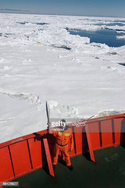 Ashleigh Pollock a crew member of the Aurora Australis holds the Queen's baton on December 13 2005 in Antartica The Baton arrives in Australia on...