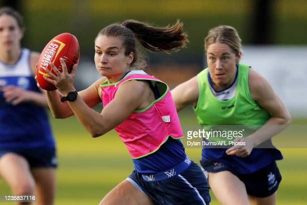 Ashleigh Riddell of the Kangaroos in action during the North Melbourne training session at Arden Street Oval on October 12, 2021 in Melbourne,...