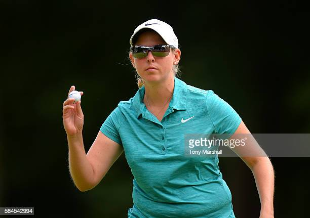 Ashleigh Simon of South Africa acknowledges the applause from the gallery on the 18th green during the Ricoh Women's British Open Day Two at Woburn...