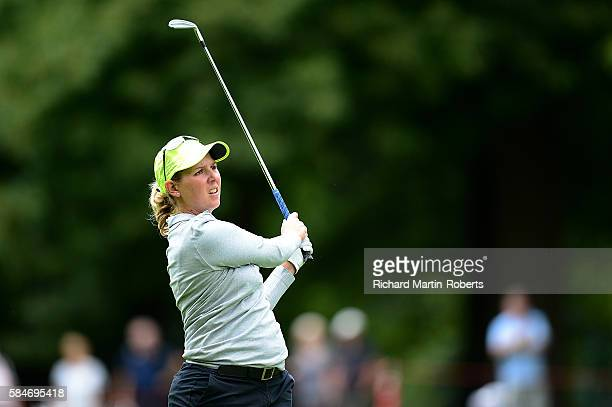 Ashleigh Simon of South Africa hits her second shot on the 1st hole during the third round of the Ricoh Women's British Open at Woburn Golf Club on...