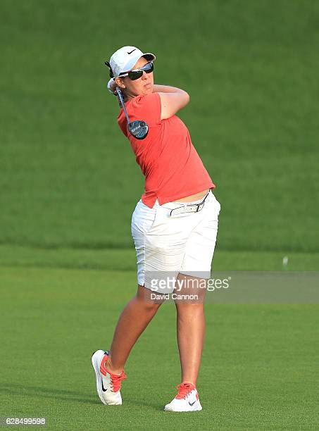 Ashleigh Simon of South Africa plays her second shot on the ninth hole during the completion of the first round of the 2016 Omega Dubai Ladies...